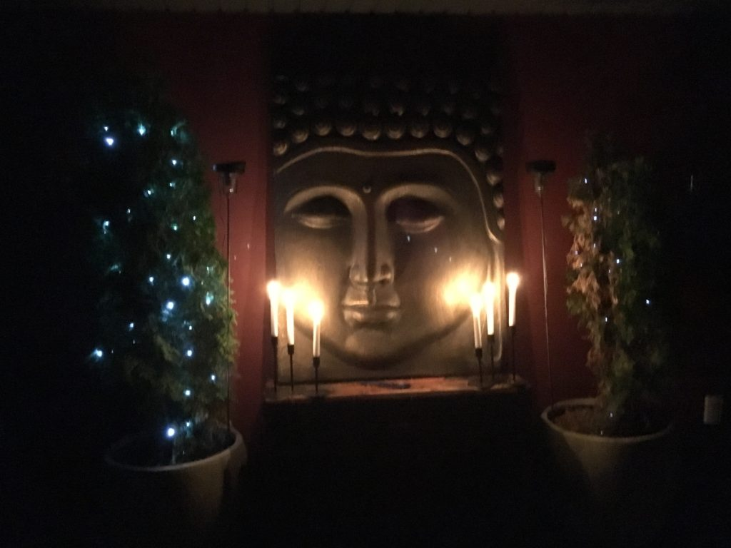 Garden buddha with candles